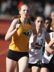Southeast Polk's Mattison Plummer runs at the front of the 3,000-meter pack at the Simpson College High School Classic on March 26 in Indianola.