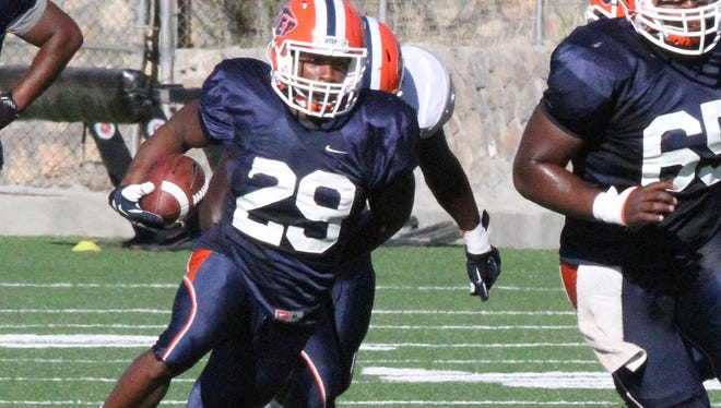 UTEP junior running back Aaron Jones takes the hand-off Tuesday at Glory Field.