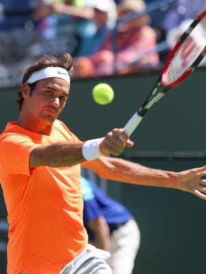 Roger Federer hits a shot during his win over Milos Raonic at the BNP Paribas Open, Saturday, March 21, 2015.