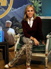 "In this Oct. 10, 2014 photo,designer Tory Burch poses for a photo during an event helping to kick off the release of her first book, ""Tory Burch In Color,""  in Dallas. The book is set to be released Tuesday, Oct. 13, and includes photographs of trips Burch's parents took and snapshots from vacations she has gone on with her children, interiors of homes, images of works of art and fashions from her collections. Also featured are music playlists, reading suggestions and interviews with notable people, including Carolina Herrera and Hillary Rodham Clinton."
