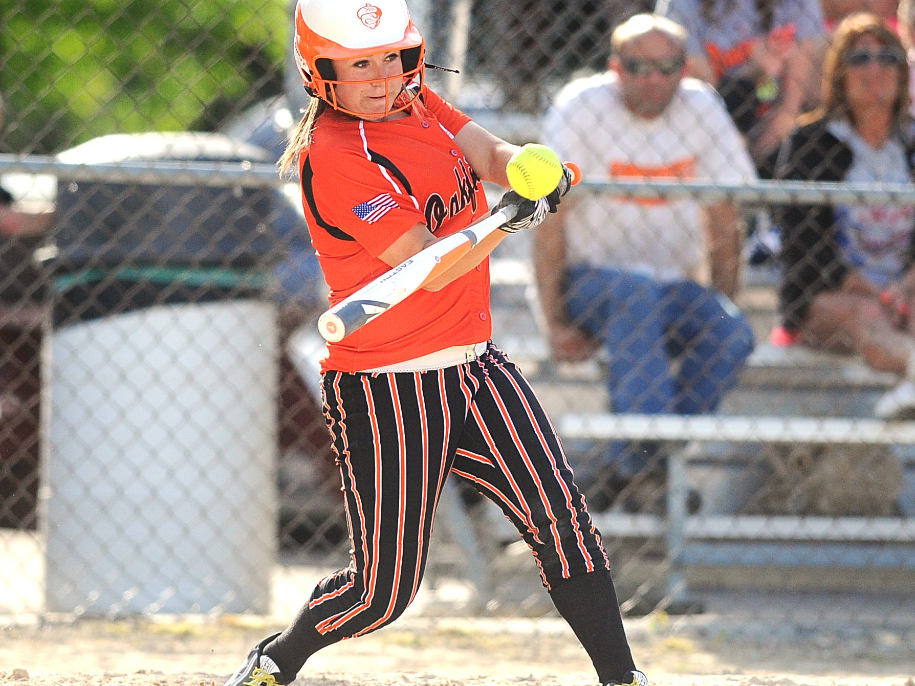 Oakfield's Alyssa Sabel singles in the second inning during the Oaks' game Friday against Oconomowoc.
