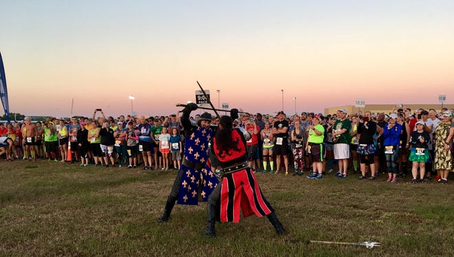 """""""Knights"""" from Medieval Times start the 2018 Excalibur 10 Miler."""