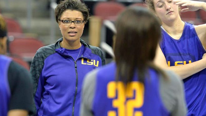 LSU head coach Nikki Caldwell addresses her team during practice at the NCAA college basketball tournament in Louisville, Ky., Saturday, March 29, 2014. LSU plays Louisville in a regional semifinal on Sunday.