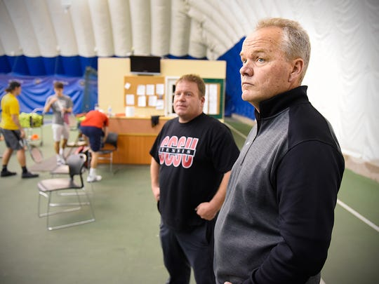 St. Cloud State University head tennis coach Jerry Anderson, right, and assistant men's coach Mark Muntifering talk about SCSU's decision to cut the men's and women's programs during practice Tuesday, May 3, at Fitness Evolution in Sartell.