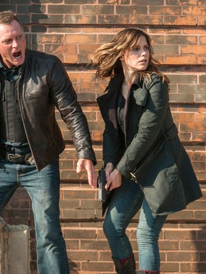 Jason Beghe is Detective Sgt. Hank Voight, left, and Sophia Bush plays Erin Lindsay in a scene from 'Chicago P.D.'