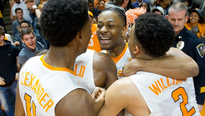 Tennessee's Robert Hubbs III (3) celebrates with his teammates during an NCAA SEC basketball game between Alabama and Tennessee at Thompson-Boling Arena in Knoxville, Tennessee on Saturday, March 4, 2017.