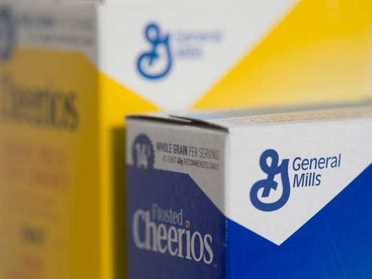 Boxes of General Mills' Cheerios cereal are arranged for a photo.
