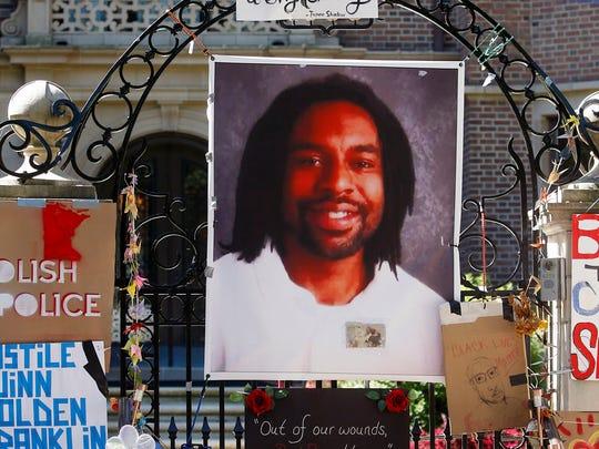 A memorial including a photo of Philando Castile adorns