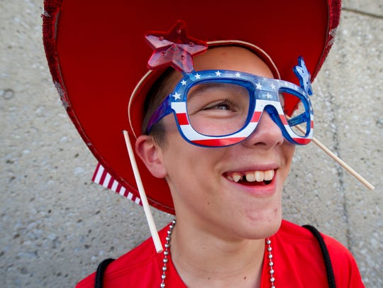 Jaden Edwards, 12, of Adams is decked out with Fourth