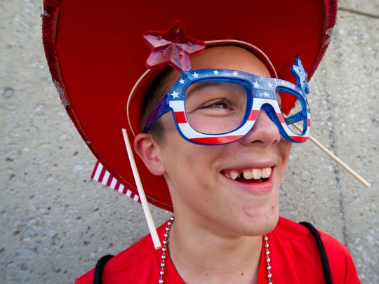 Jaden Edwards, 12, of Adams is decked out with Fourth of July attire as he laughs while in the shade during Fourth of July celebrations in downtown Nashville, Tenn., Tuesday, July 4, 2017.