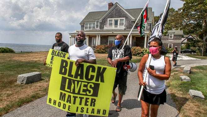 Black Lives Matter members walk at the site of an Aug. 3 racial incident caught on video in Barrington.