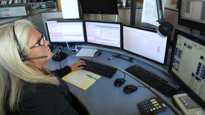 Dispatcher Lori Abrams takes calls for MFD last week at the Delaware County Dispatch Center.