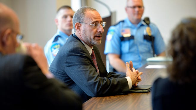 U.S. Attorney Andy Luger (center) meets with a room full of area attorneys and law enforcement officials Tuesday afternoon at the Stearns County Administration Building.