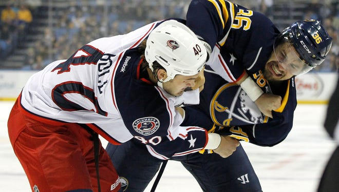 Columbus Blue Jackets right wing Jared Boll takes on Buffalo Sabres right wing Patrick Kaleta after his hit on Jack Johnson.