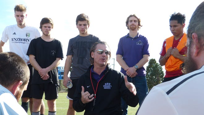 """Redding Royals men's semipro soccer team coach Ben Wade, who was a three-time contestant on the reality TV show """"Survivor,"""" speaks to his players following a practice at University Preparatory School."""