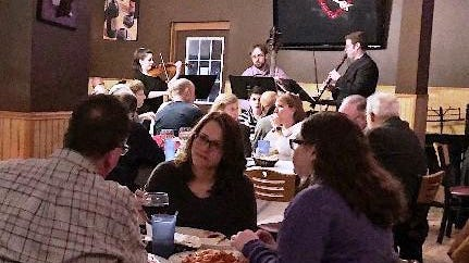 From left, Adrienne Harmon (violin), Andrew Trombley (bass) and Andrew Verdino (clarinet) entertain at last year's Aperitivo event in Monticello to benefit the Sullivan County Chamber Orchestra. This year's event will take place on Jan. 18.