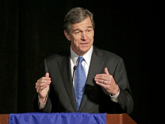 North Carolina Attorney General Roy Cooper speaks during a forum in Charlotte, N.C., in June. North Carolina Gov. Pat McCrory conceded the governor's race to Cooper on Dec. 5, 2016.
