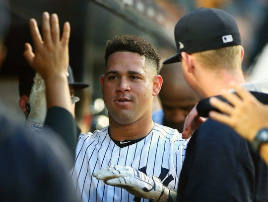 Yankees catcher Gary Sanchez is congratulated by teammates