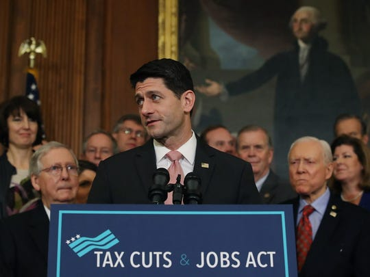 House Speaker Paul Ryan and the Tax Cuts & Jobs Act on Dec. 21, 2017.