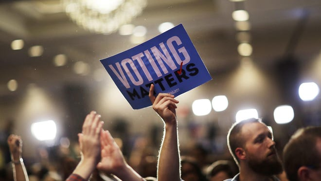A supporter holds up a sign while attending the election night party of Democratic candidate for 6th congressional district Jon Ossoff in Atlanta, Tuesday, June 20, 2017. (AP Photo/David Goldman)