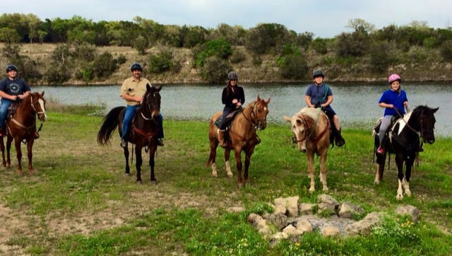 Millicent Mathews, her husband and three children go horseback riding during a Mardi Gras trip to the hill country near Austin, Texas in 2015.