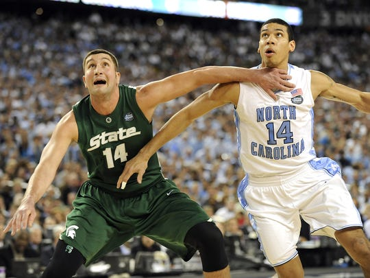 MSU's Goran Suton fights for position  with North Carolina's Danny Green   in Detroit during MSU's Final Four championship  game against North Carolina Monday April 6, 2009.