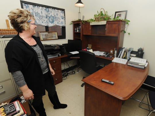 Tammy Hettinger, Solace of Ross County coordinator, gives a tour of the men's shelter Thursday in Sherman Park. Solace of Ross County has moved its offices to the shelter.