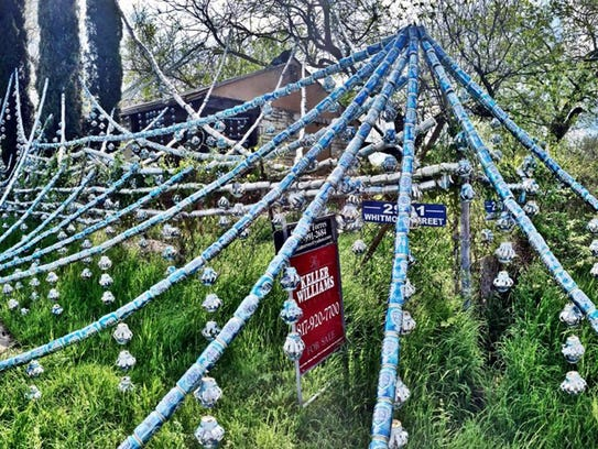 Thousands of cans of beer line the property in Fort