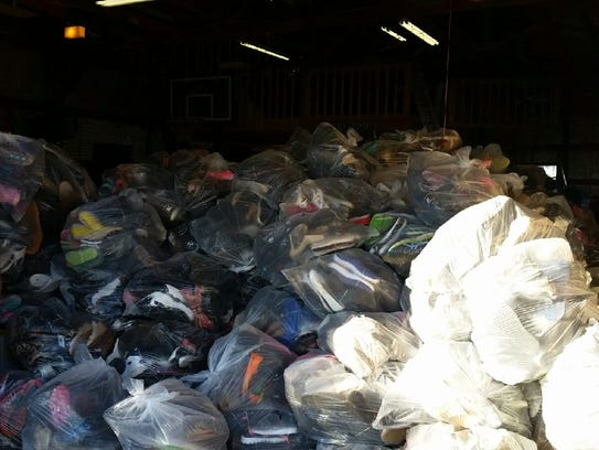 Bags of shoes donated to raise money for Dakota's surgery.