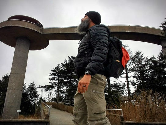 Benny Braden takes a break on a hike by Clingmans Dome