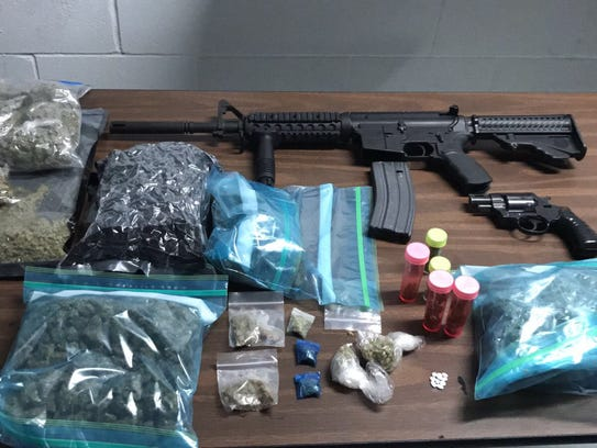Guns and drugs confiscated in a June 29 drug bust at