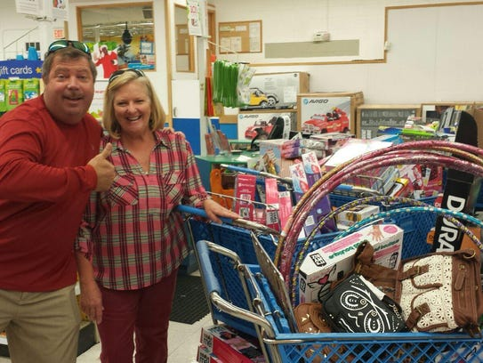 Mike and Marsha Ewing shop for toys to make the season