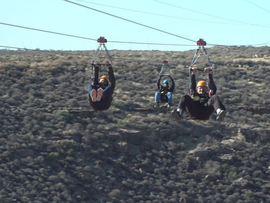Riders fly on the new zip-lines of Grand Canyon West.