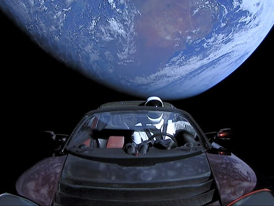 """SpaceX's """"Starman,"""" a mannequin dressed in a spacesuit,"""