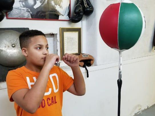 Elijah Karlovetz, 12, of Fremont, will fight for the