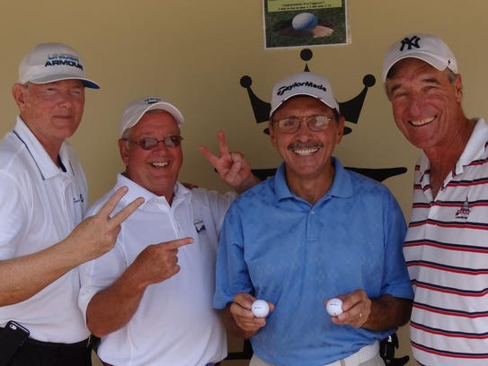 Naples' Rico Caggiano holds balls from his two holes-in-one,