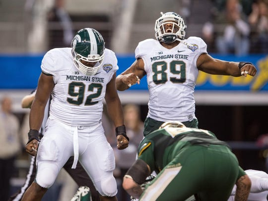 MSU defensive tackle Joel Heath (92) and defensive end Shilique Calhoun (89) celebrate their sack of Baylor quarterback Bryce Petty during the second half of the Cotton Bowl Classic on Jan. 1 at AT&T Stadium.