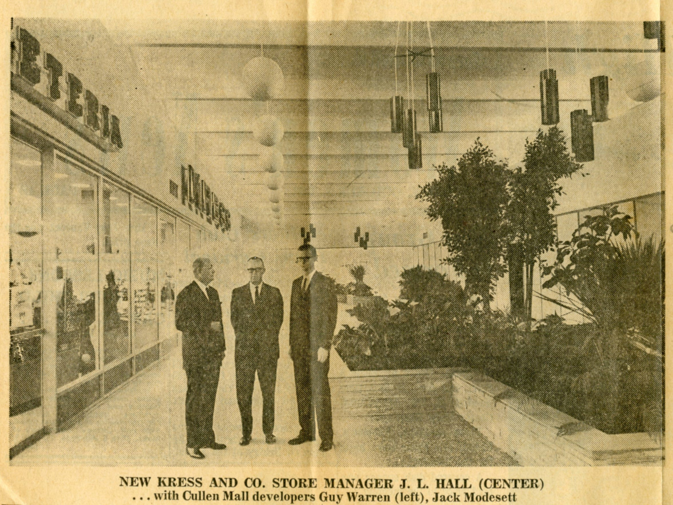 Kress and Co. store manager J.L. Hall (center) with