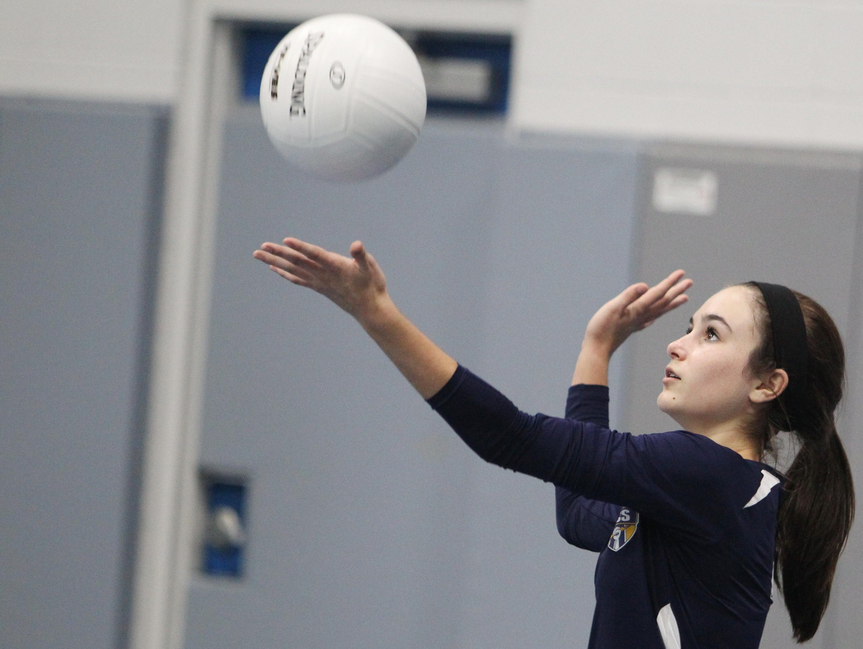Community Christian School eighth grader Abby Watson prepares to serve in a game against Christ's Church Academy.
