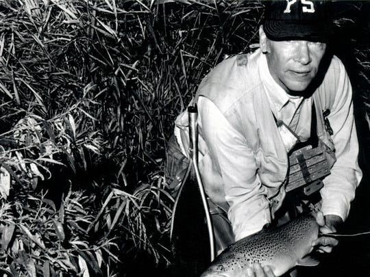 Joe Humphreys poses with yet another trophy trout.