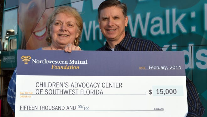 Rich Durnwald presents a $15,000 check to Jill Turner, CEO, Children's Advocacy Center of Southwest Florida. Durnwald was named a Community Service Award recipient from the Northwestern Mutual Foundation, earning him a grant for the nonprofit.