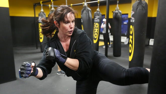 Jen Zelop, co-owner of CKO Kickboxing in Peekskill, leads a kickboxing class on Feb. 12, 2014.   They opened in the spring of 2013.