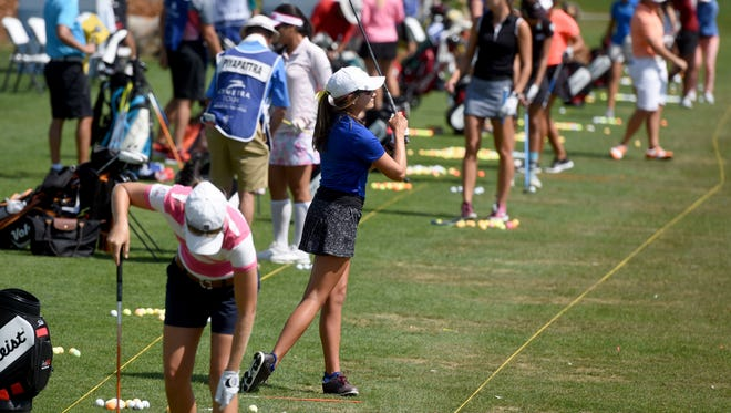 Sydney Bormann practices on the driving range during the Symetra Tour at Willow Run Golf Course. Bormann is the only South Dakotan participating in the tour.