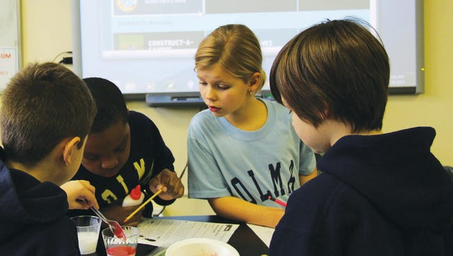 Students engage in research in the Our Lady of Mercy Academy science lab.