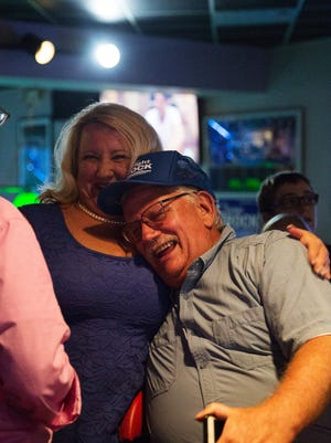 Collier County Clerk Dwight Brock celebrates with Meredith Carr after learning he won his seventh term at Nemo's Sports Cafe on Tues. Aug. 30, 2016 in Naples, Florida. Brock defeated Commissioner Georgia Hiller 38,838 to 17,029 or with 70 percent of the unofficial vote.