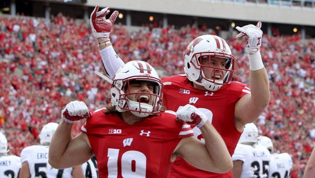 Wisconsin defenders Leo Musso (front) and T.J. Watt will face high-scoring Michigan on Saturday.