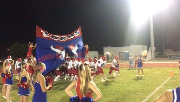 Mesa Mountain View takes the field at Dobson High School in Mesa.