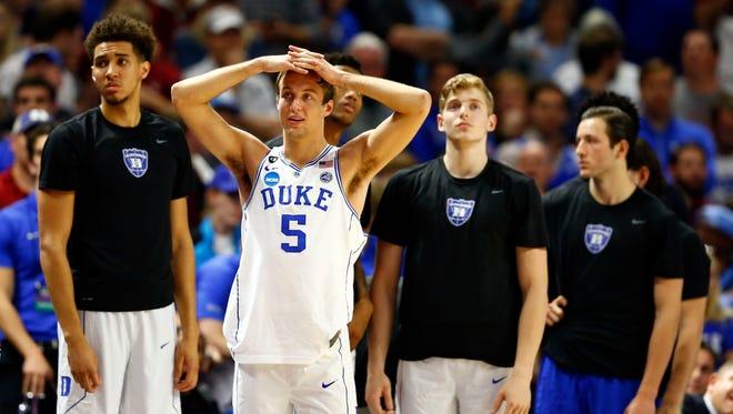 Duke Blue Devils guard Luke Kennard looks on as the season goes up in smoke.