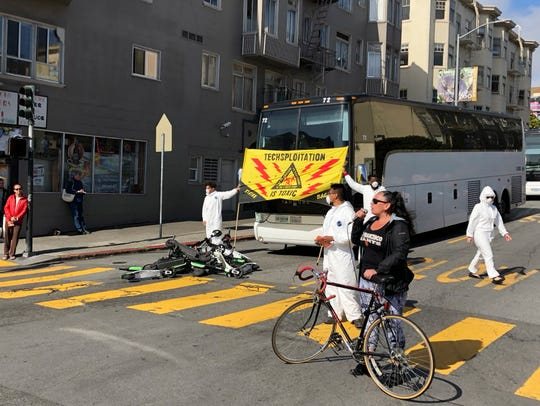 A group of activists block commuter tech buses in the Mission District with motorized scooters during a protest May 31, 2018, in San Francisco.