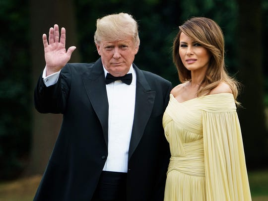 President Donald Trump poses with  first lady Melania Trump at the U.S. ambassador's residence, Winfield House, in London on July 12, 2018, heading to Blenheim Palace for a dinner on the first day of a UK visit.